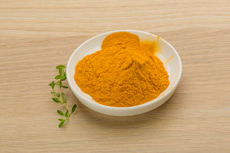 curcumin: Curcuma powder in the bowl Stock Photo