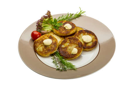 browns: Hash browns with herbs on the plate
