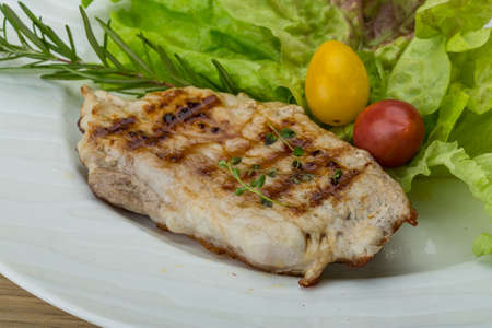 schnitzel: Grilled pork schnitzel with rosemary and salad leaves