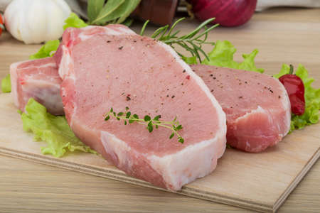 roast pork: Raw pork steak - ready for cooking with herbs