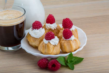 profiterole: Profiterole with raspberry and cup of coffee