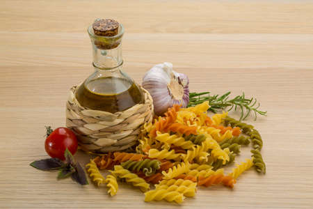 Raw fusilli with rosemary and tomato photo