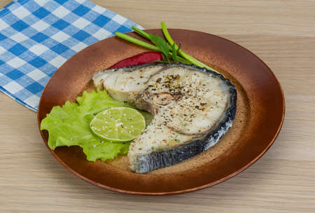 shark catfish: Grilled shark stesk with lime and salad leaves