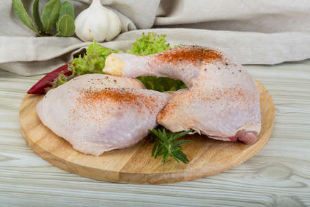 Chicken thigh with rosemary, pepper and salad leaves photo