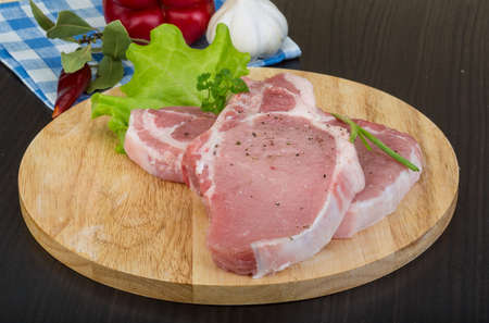 tbone: Raw t-bone steak with spices and herbs