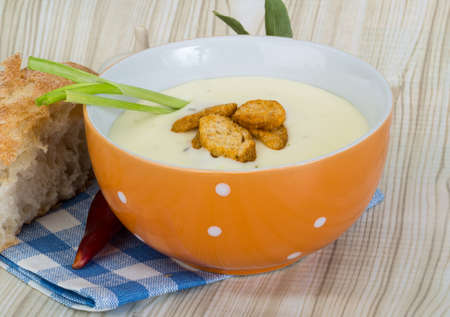 Cheese soup with croutons, herbs and spices photo