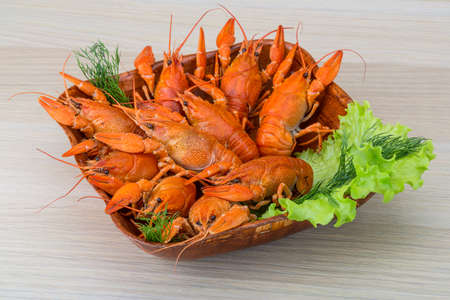 Boiled crayfish in the bowl with dill photo