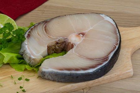 shark catfish: Raw blue shark steak with salad leaves and lime