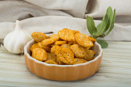 crouton: Crouton in the bowl on wooden background Stock Photo
