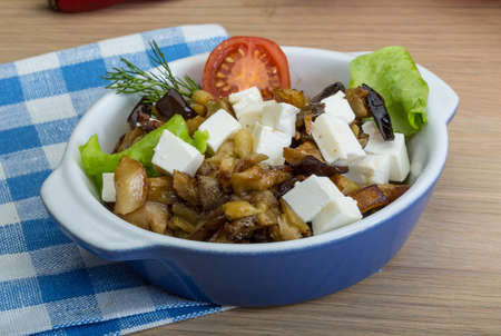 aubergine: Aubergine with greek cheese and salad leaves