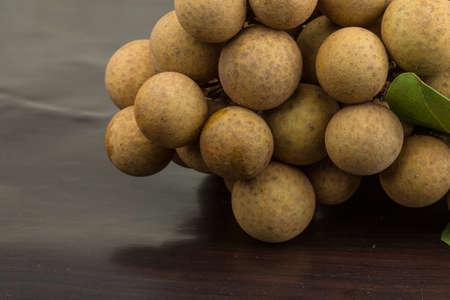 flesh colour: Asian fruit Longan - on wood