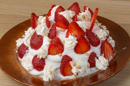 Homemade Strawberry cake with cream and cedar nut photo