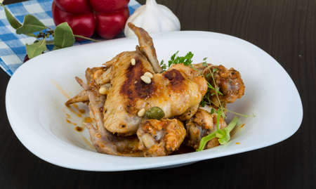 Roasted chicken wings with spices in the bowl photo