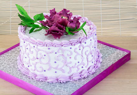 pion: Wedding cake with flower - pion on wood background Stock Photo