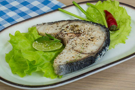 Grilled shark stesk with lime and salad leaves photo