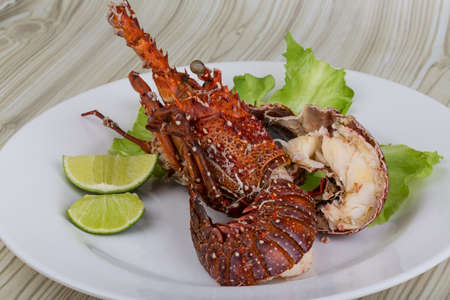 Spiny lobster grilled with lime and spices Stock Photo