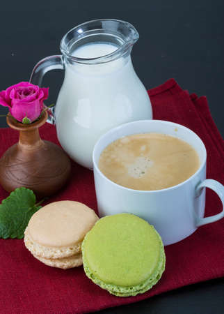 Coffee with macaroons and milk served rose photo
