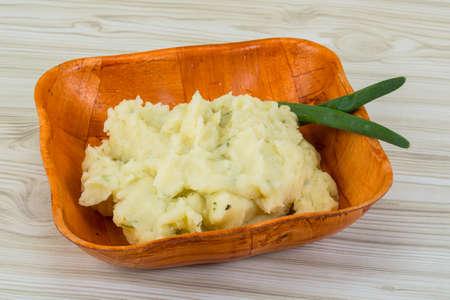 mash: Mash potato in the bowl with green onion Stock Photo