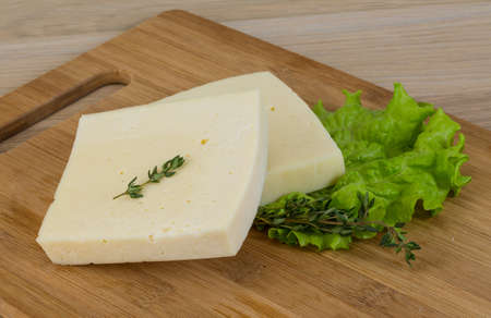 cheddar: Yellow cheddar with thyme and salad leaves Stock Photo