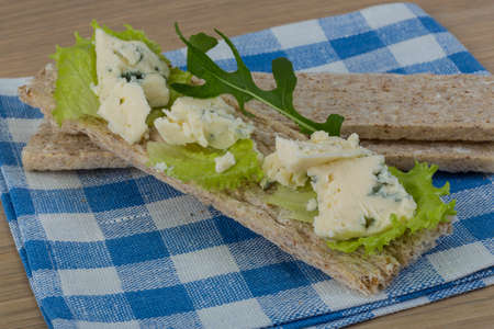 crispbread: Crispbread with soft blue cheese and salad