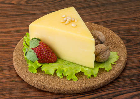 Parmesan: Parmesan cheese triangle with strawberry and wallnuts