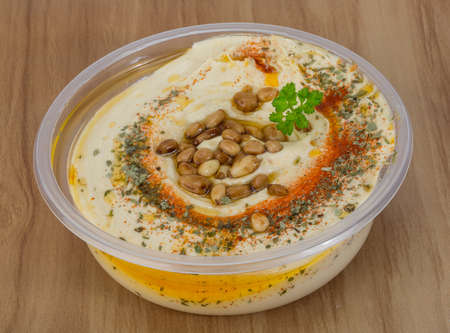 paprica: Hummus in the bowl with paprica and cedar nut Stock Photo