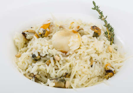 cuttlefish: Risotto with mussels and cuttlefish served fresh thyme