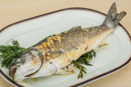 seabass: Grilled seabass with fresh rosemary and dill Stock Photo