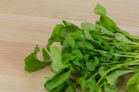 roquette: Fresh Rucola leaves on the wood background