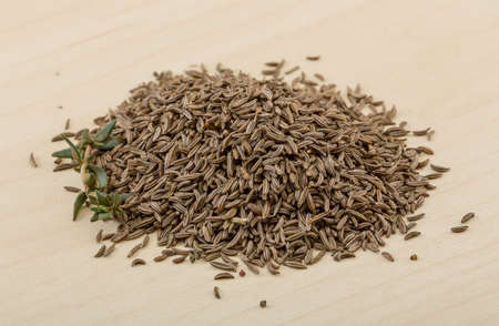 caraway: Dry caraway heap on the wood background