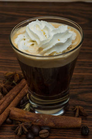 capuccino: Coffee capuccino with cream and cinamon and star-anise