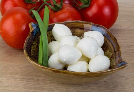 Mozzarella cheese balls with onion and tomato branch photo
