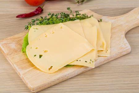 cheddar: Sliced cheddar on the board with thyme