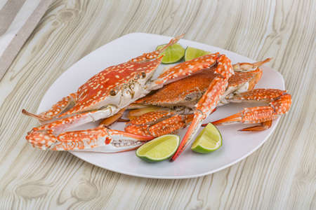 crab meat: Boiled crabs with lime on the wood background