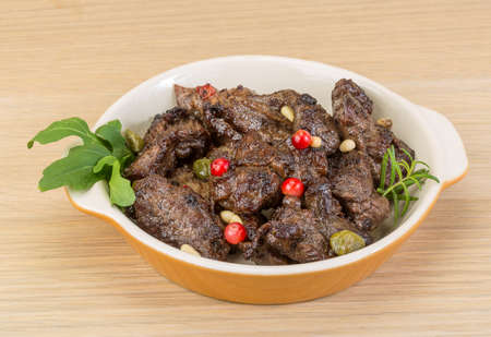 ruccola: Roasted venison meat with ruccola and cranberries Stock Photo