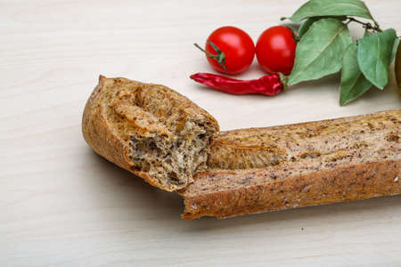 artisan bakery: French Bread Baguette on the wood background