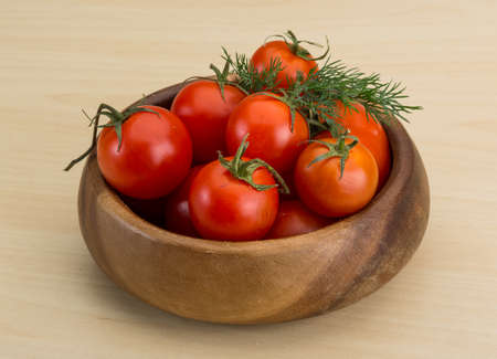 Fresh ripe Cherry tomatoes in the basket photo