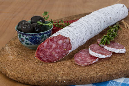 Fuet sausage - Spanish meat sliced with herbs photo
