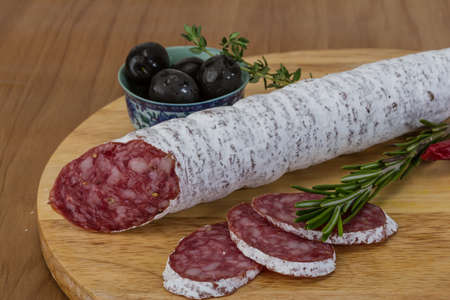 embutido: Fuet sausage - Spanish meat sliced with herbs Stock Photo