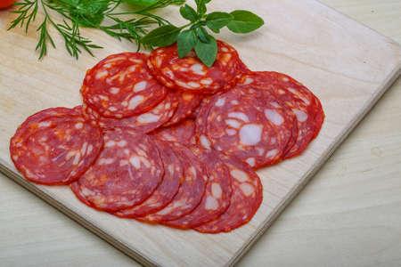 Chorizo sausage - spanish salami on the wood background photo