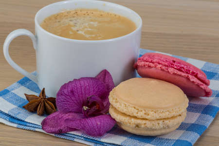 capuccino: Capuccino with macaroons served orchid flower Stock Photo