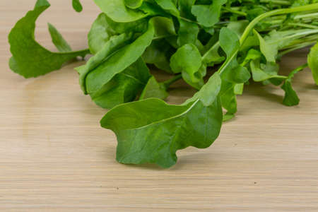 roquette: Fresh Rucola leaves on the wood