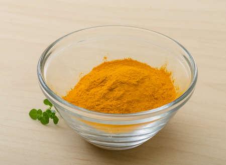 tumeric: Yellow Tumeric powder in the glass bowl