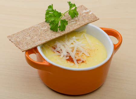 Cheese soup with crutoons and fresh herbs photo