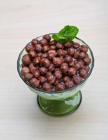 chocolate cereal: Chocolate cereal balls with milk - dietary breakfast