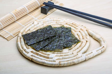 nori: Nori sheets with sticks on the wood