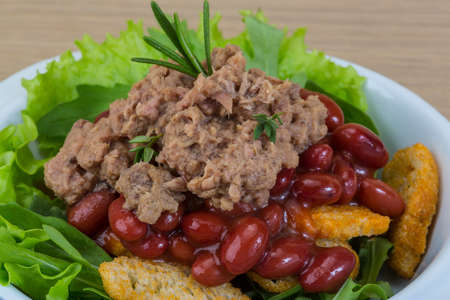 Tuna salad with beans, ruccola and croutons photo