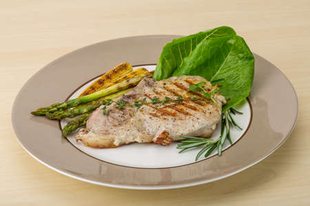 baby corn: Pork steak with grilled asparagus and baby corn