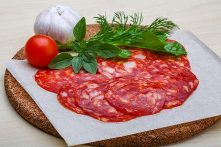 salame: Chorizo sausage - spanish salami on the wood background