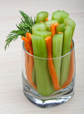 carrot: Celery and carrot sticks in the glass